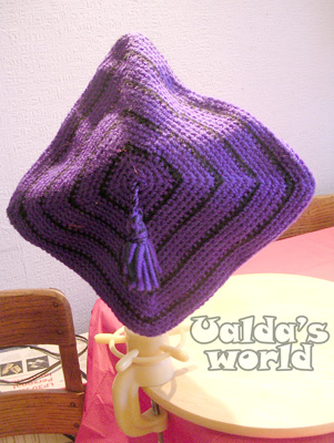 Purple & black crocheted mortar board with tassel