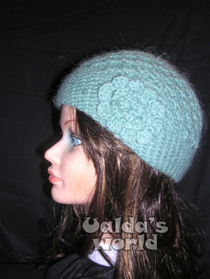 Turquoise skullcap with flower
